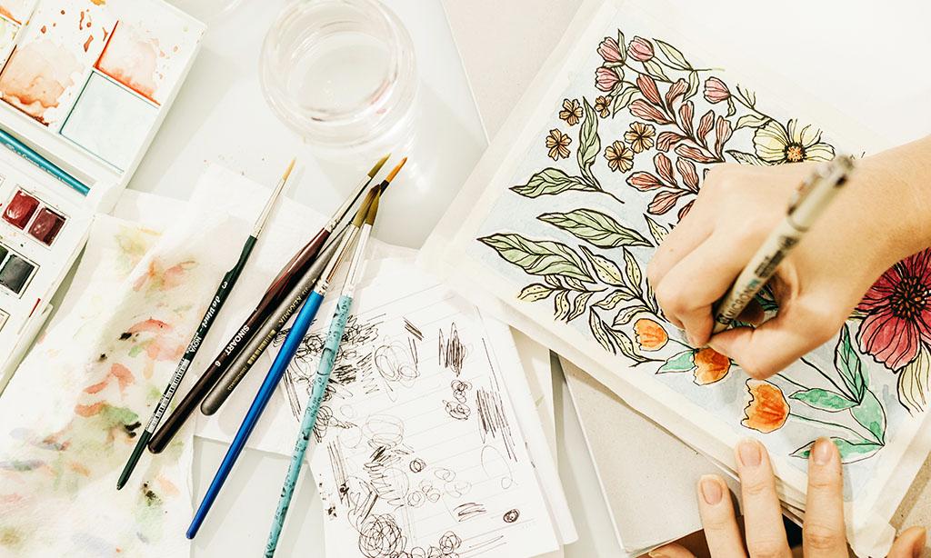 artist drawing in a sketchbook